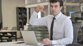 banqueiro : Thumbs Down by Young Businessman Looking at Camera Stock Footage