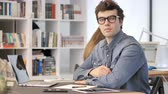 Creative Man Looking at Camera in Office