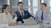 驚き : Executive Business people get Disappointed while using Laptop on Office Table