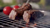 close up of cooking pork ribs on the grill barbecue Stock Footage