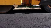 steamroller : Road Construction in blurred view. Hot asphalt is applied to the street by construction crew.