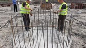 instalator : Zrenjanin, Vojvodina, Serbia - April 23, 2015: Workers are tying rebar to make a newly constructed footing frame. Binding concrete frame