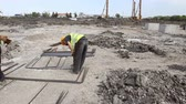 instalator : Zrenjanin, Vojvodina, Serbia - April 23, 2015: Worker is measuring the length of reinforcing steel, armature at construction site. Wideo