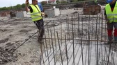 alicate : Zrenjanin, Vojvodina, Serbia - April 23, 2015: Workers are tying rebar to make a newly constructed footing frame. Binding concrete frame