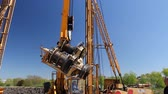 drilling site : Zrenjanin, Vojvodina, Serbia - April 23, 2015: Mobile crane is operating, lifting a broken transmission for fixing.
