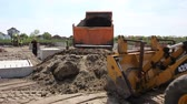 csikk : Zrenjanin, Vojvodina, Serbia - April 30, 2015: Dumper truck is unloading soil or sand at construction site.