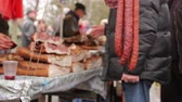 dry sausage : Cured meat and sausages hang for sale at outdoor flea market.