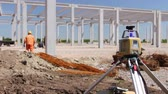 Total center device on tripod with laser for leveling other devices to level construction site. Photo - JPEG video codec