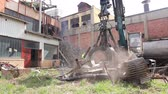 View on machine, loader manipulator with hydraulic grappling claw until is collecting, moving old steel, scrap metal. Photo - JPEG video codec Wideo