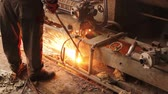 lakatosmunka : Worker is cutting manually old, scrap, metal construction using gas mixture of oxygen and acetylene, propane.Photo - JPEG video codec