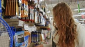 papier : Young beautiful woman buying stationery for school, beautiful mother choose tools in a supermarket for her children, student shopping in a supermarket