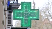 EUROPEAN PHARMACY SIGN: The green cross, often animated, is a symbol found in many countries in Europe Stock mozgókép