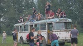 UKRAINE, TERNOPIL - July 20, 2018: Young crowd of teenagers dancing at a music festival in summer on a old retro trolleybus Stock mozgókép
