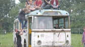 UKRAINE, TERNOPIL - July 20, 2018: Young crowd of teenagers dancing at a music festival in summer on a old retro trolleybus Vídeos