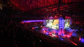 atirador : SAINT PETERSBURG, RUSSIA - OCTOBER 28 2017: EPICENTER Counter Strike: Global Offensive cyber sport event. Tribunes full of fans of the game and a big screen with live broadcast.