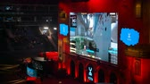 atirador : MOSCOW, RUSSIA - OCTOBER 27 2018: EPICENTER Counter Strike: Global Offensive esports event. Main stage with a big screen broadcasting game moments and player booths. Stage illuminated with red colors.