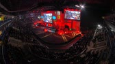 maç : MOSCOW, RUSSIA - OCTOBER 27 2018: EPICENTER Counter Strike: Global Offensive esports event. Main stage, lightning, illumination, big screen with a game moments on it. Stage pulse with a red light. Stok Video