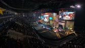 atirador : MOSCOW, RUSSIA - OCTOBER 27 2018: EPICENTER Counter Strike: Global Offensive esports event. Main stage with a big screen showing the game and player booths.