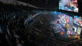 сектор : MOSCOW, RUSSIA - OCTOBER 27 2018: EPICENTER Counter Strike: Global Offensive esports event. Fans on a tribunes, arena with a lot of lights. Panning view from overlooking spot. Стоковые видеозаписи
