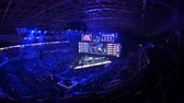 competitivo : MOSCOW, RUSSIA - 14th SEPTEMBER 2019: esports Counter-Strike: Global Offensive event. Main stage with a big screen showing the matchs game moments. Arena lit with a blue color.