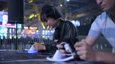 MOSCOW - 23th DECEMBER 2019: esports event. Young woman and a man playing mobile game on a smart phone at esport event at big arena.