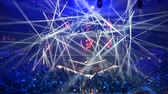 fényszóró : MOSCOW, RUSSIA - 14th SEPTEMBER 2019: esports gaming event. Amazing lighting, illumination, big screen. Russian rapper Feduk perform on a stage on the opening ceremony.