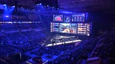 competitivo : MOSCOW, RUSSIA - 14th SEPTEMBER 2019: esports gaming event. Big venue, lighting, illumination, giant screens on a stage. Stage lit with a blue color. Arena full of young gamers. Vídeos