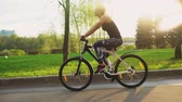 bike ride : Athletic girl on bicycle in slow motion