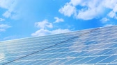 коллектор : Photovoltaic energy concept,  solar panels on blue sky Стоковые видеозаписи