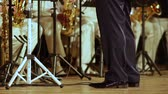 louisiana : Legs conductor of brass band in black trousers and patent leather shoes.