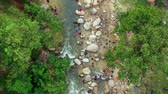 Aerial footage of people picnic along the river taken in Kuala Woh Recreational Forest in Tapah Perak, Malaysia. Dostupné videozáznamy