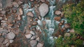 Scenic aerial view of water stream through the stones inside the jungle Dostupné videozáznamy
