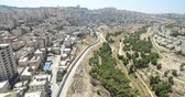 рельсы : Israel and Palestine divided by Security wall Aerial view Aerial view of Left side Anata Palestinian town and from the right Israeli neighbourhood Pisgat zeev Стоковые видеозаписи