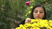 beauty female face : Teenager girl smelling flowers Stock Footage