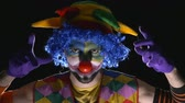 horrifying : Young hilarious evil clown making scary faces Stock Footage