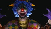horrifying : Young hilarious clown making scary faces and laughing