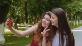 charming : Happy friends taking selfie with the smartphone in the park