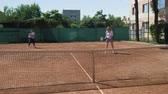 çiftler : Two girl friends playing doubles tennis match winning and enjoying their triumph