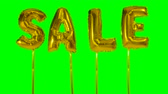 cupom : Word sale from helium golden balloon letters floating on green screen Vídeos
