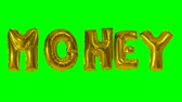 soletrar : Word money from helium gold balloon letters floating on green screen Stock Footage