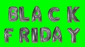 earn : Word black friday from helium silver balloon letters floating on green screen