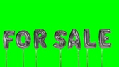 esgotado : Word for sale from helium silver balloon letters floating on green screen Stock Footage