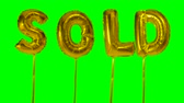 販売さ : Word sold from helium golden balloon letters floating on green screen 動画素材