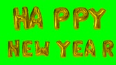 helyum : Word Happy New Year text greeting from helium golden balloon letters floating on green screen