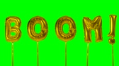 kiabálás : Word boom from helium golden balloon letters floating on green screen Stock mozgókép