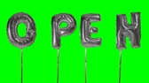 soletrar : Word open from helium silver balloon letters floating on green screen Stock Footage