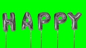 textových zpráv : Word happy from helium silver balloon letters floating on green screen