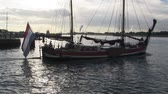 holandia : Historic Dutch tugboat underway with flag, The Netherlands Wideo