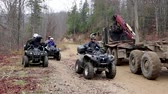 주기 : Ukraine, Bukovel - November 20, 2019: a group of tourists from three ATVs in the forest rides along impassable roads and along a narrow dirt road, drives through and waits for oncoming traffic. 무비클립
