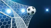filet : Soccer ball flies beautifully into the goal in slow motion. Soccer ball flies into the goal bending the grid on flares background, ball rotating in slow motion. Moment delight football 3d 4k animation